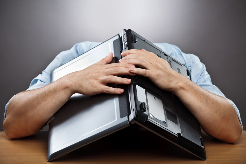 10497029 - portrait of an exhausted businessman covering his head with his laptop